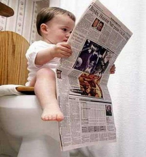 Kid-in-Toilet-and-Reading-Newspaper