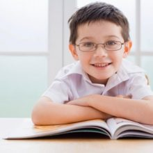 young_boy_with_glasses_and_open_book