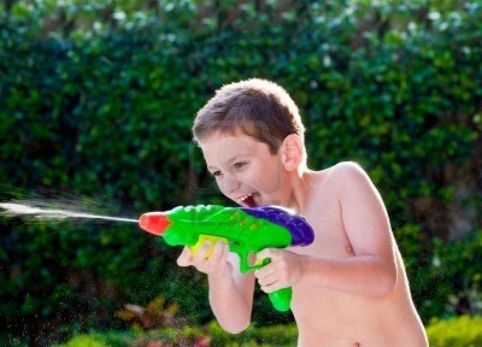 kid-playing-with-water-toy-in-the-summer