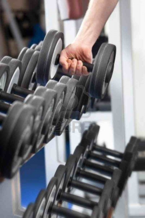 4370316-close-up-of-man-holding-weight-in-gym