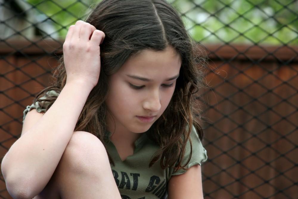 teen-girl-sad-head-down