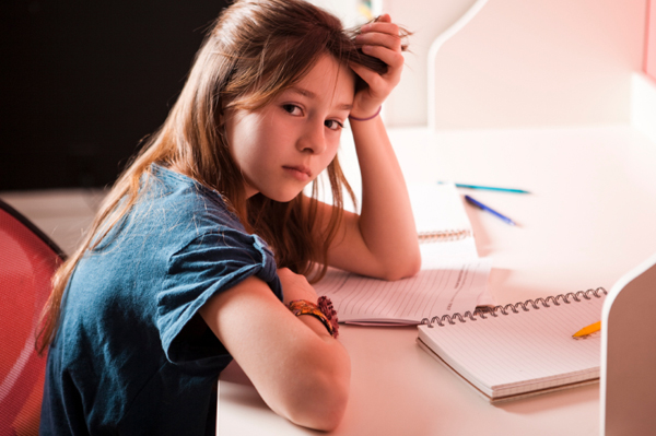 upset-girl-doing-homework
