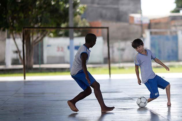Gabriel Muniz, 11, plays soccer with schoolmates in Campos dos Goytacazes