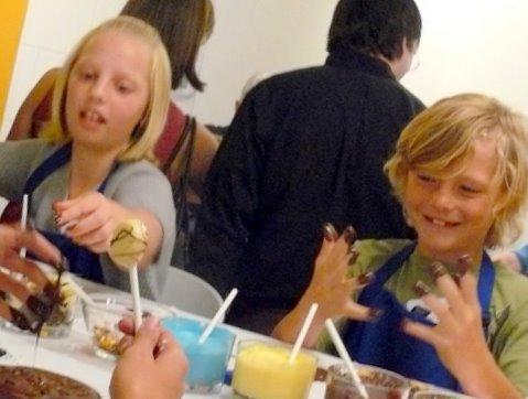 Kids smear chocolate