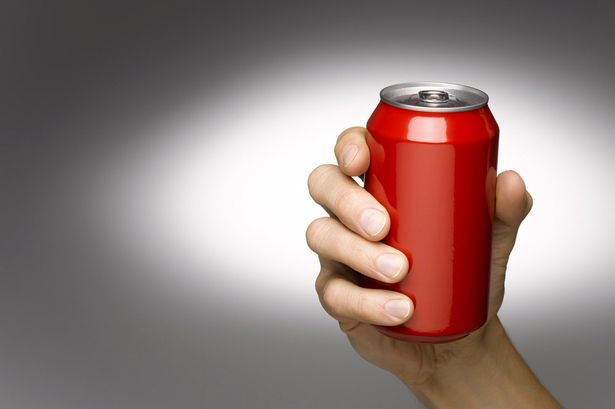 Hand+Holding+Beverage+Can