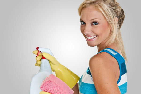 woman-with-cleaning-supplies-gloves