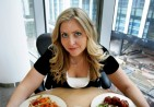 a_beautiful_woman_eating_food_from_a_bowl_1340129520
