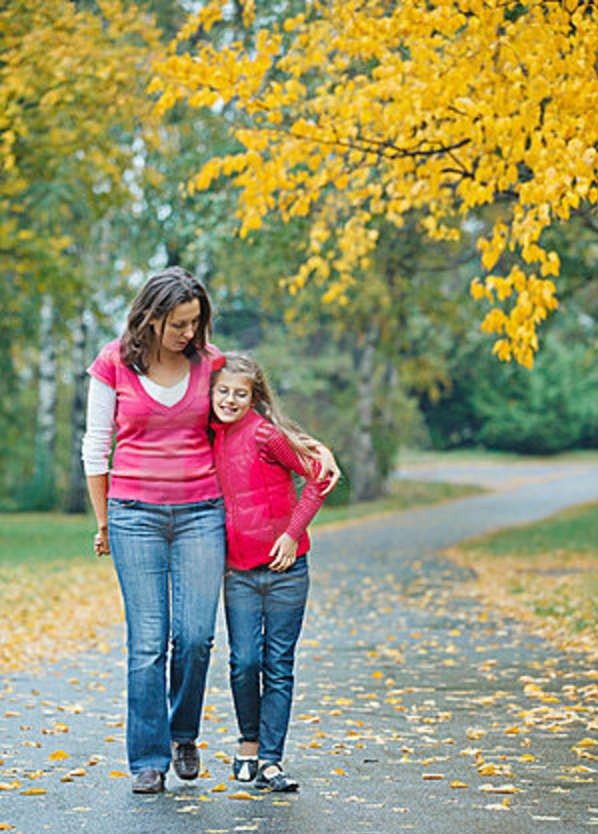 girl-her-mother-walking-park