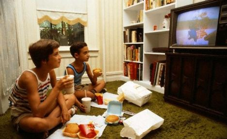 Boys Eating and Watching Television