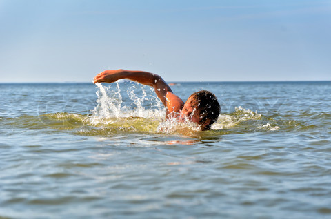 Young male swimming in the sea/ocean