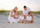 Family-looking-at-sea-shells-together-Myrtle-Beach-State-Park-11062611