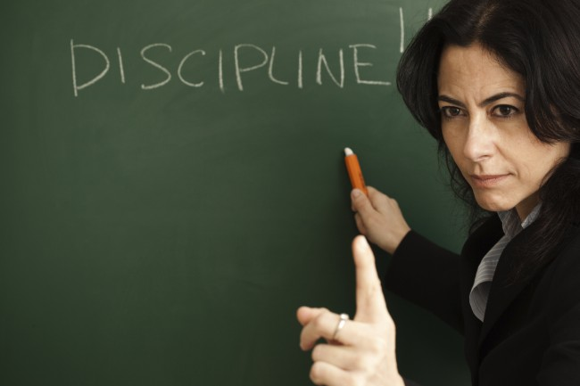 Teacher-with-Discipline-Written-on-Board-for-Blog