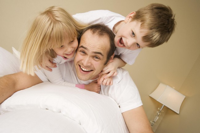 father with two kids playing