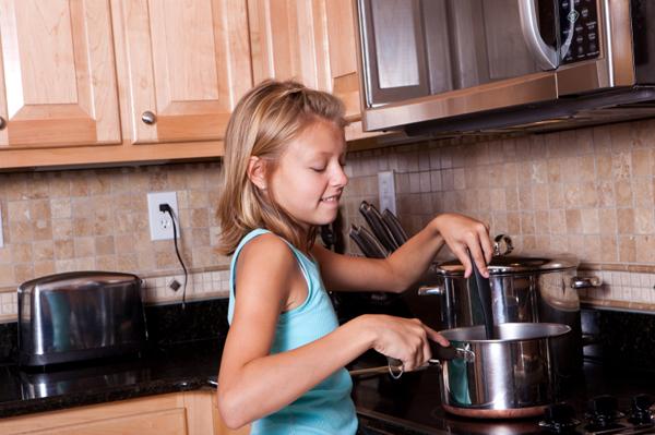 tween-girl-cooking-dinner-at-home