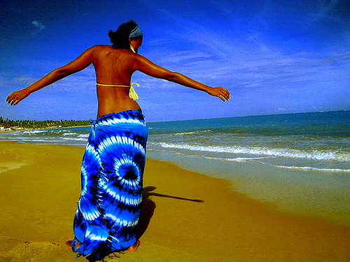 woman-on-beach-in-blue-sarong