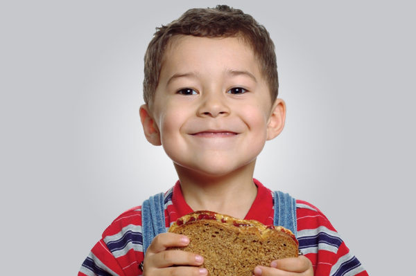toddler-eating-whole-wheat-sandwich