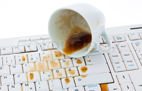 Coffee cup on computer keyboard