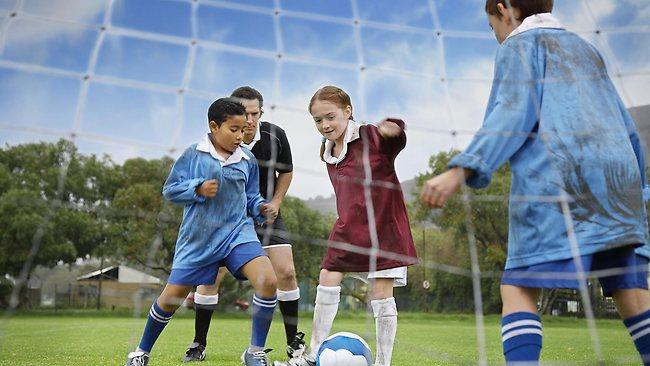 925844-kids-playing-soccer
