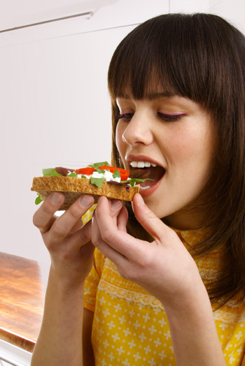 woman-eating-healthy-sandwich