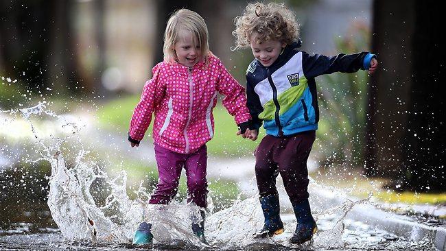 261755-kids-splahshing-in-puddlesmn