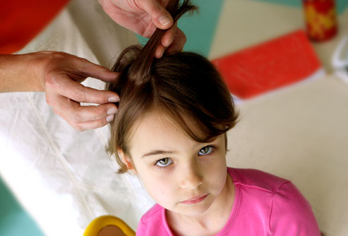 PRinc_rm_photo_of_school_lice_examination