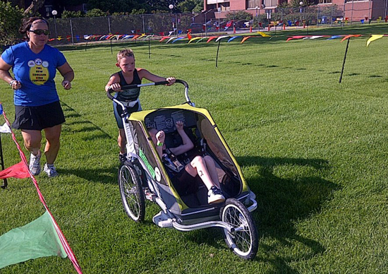 conner-long-pushes-cayden-in-triathlon