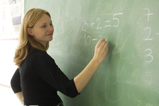 elementary teacher at blackboard