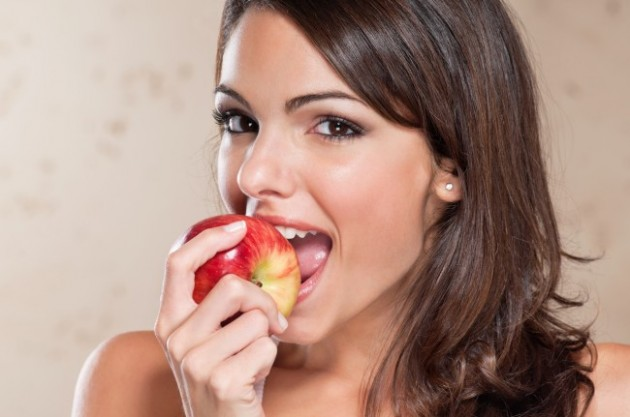 pretty-young-woman-eating-an-apple