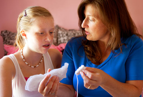 webmd_photo_of_mother_explaining_tampon