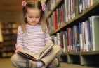 Young-girl-reading-in-lib-001