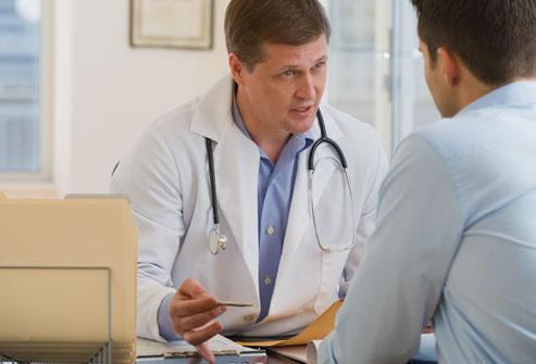 getty_rf_photo_of_doctor_diagnosing_psoraisis