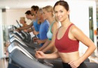 Woman On Running Machine In Gym