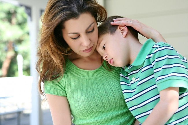 bigstock_Tired_Boy_At_Home_With_Mother_6566172