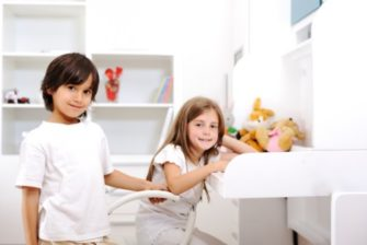 siblings-boy-and-girl-in-room