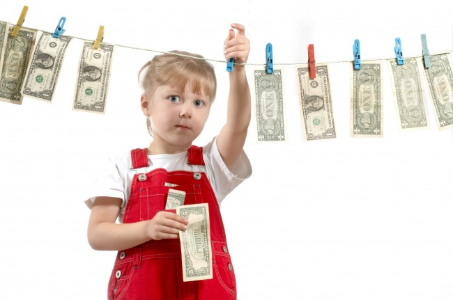 Kid-Hanging-Up-Money