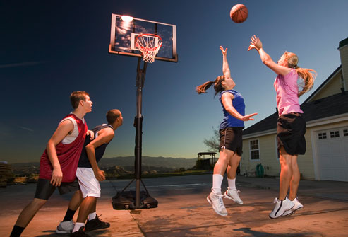getty_rm_photo_of_teens_releasing_stress_with_basketball_game