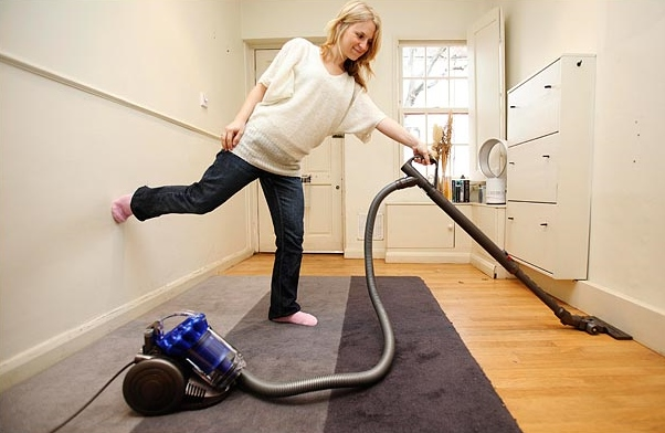 woman-holding-vacuum-cleaners