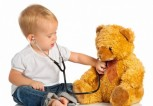 Baby-plays-in-doctor-toy-bear-and-stethoscope-780x569