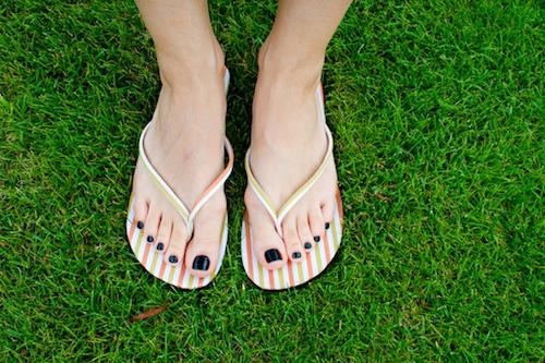 woman-wearing-sandals-nail-polish