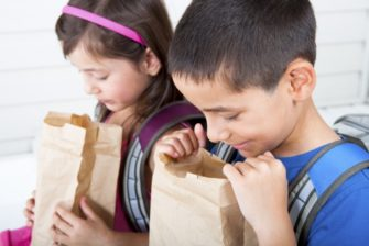o-CHILD-EATING-LUNCH-IN-SCHOOL-facebook
