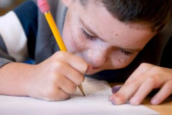 Boy_writing_with_pencil