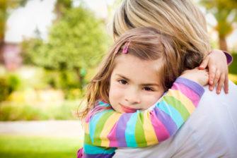 mom-hugging-sensitive-little-girl