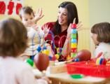 three-little-girls-and-female-teacher-in-kindergarten