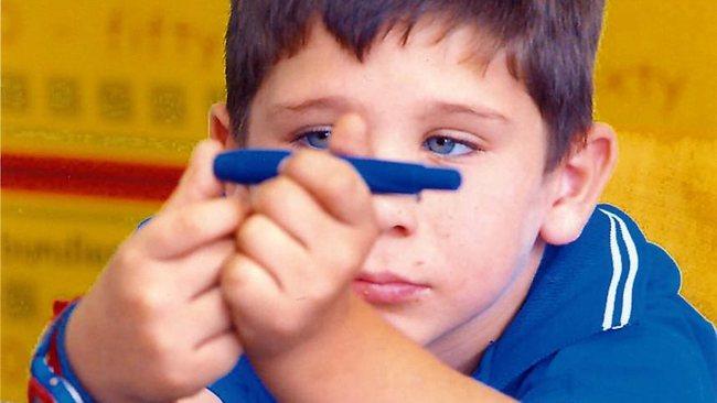 651652-child-taking-his-own-insulin-prick-test