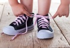 bigstock-Child-Successfully-Ties-Shoes-34396691