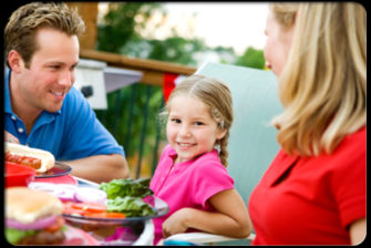 10-ways-to-raise-food-smart-kids-s1-photo-of-girl-eating-lunch-with-parents