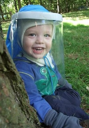 238459AD00000578-2850249-Three_year_old_Eddison_Miller_must_wear_a_UV_protective_suit_and-1_1417009776846