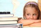 bigstock-Little-girl-with-books-26656088-580x387