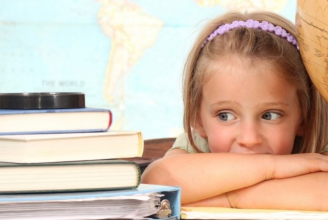 bigstock-Little-girl-with-books-26656088-580x387
