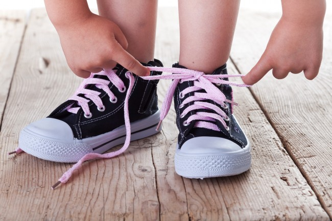 bigstock-Child-Successfully-Ties-Shoes-34396691 625471cc5f2